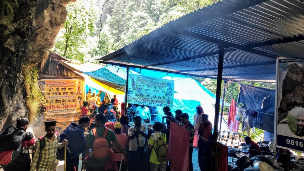 THIS IS THE 2ND STOP BARATINALA, WHERE LOCALS GIVING FREE FOOD TO PILGRIMS